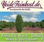 Text-Bild-Grafik. Heide-Feinkost so schmeckt die Heide. Heidschnucke vor Heidelandschaft.